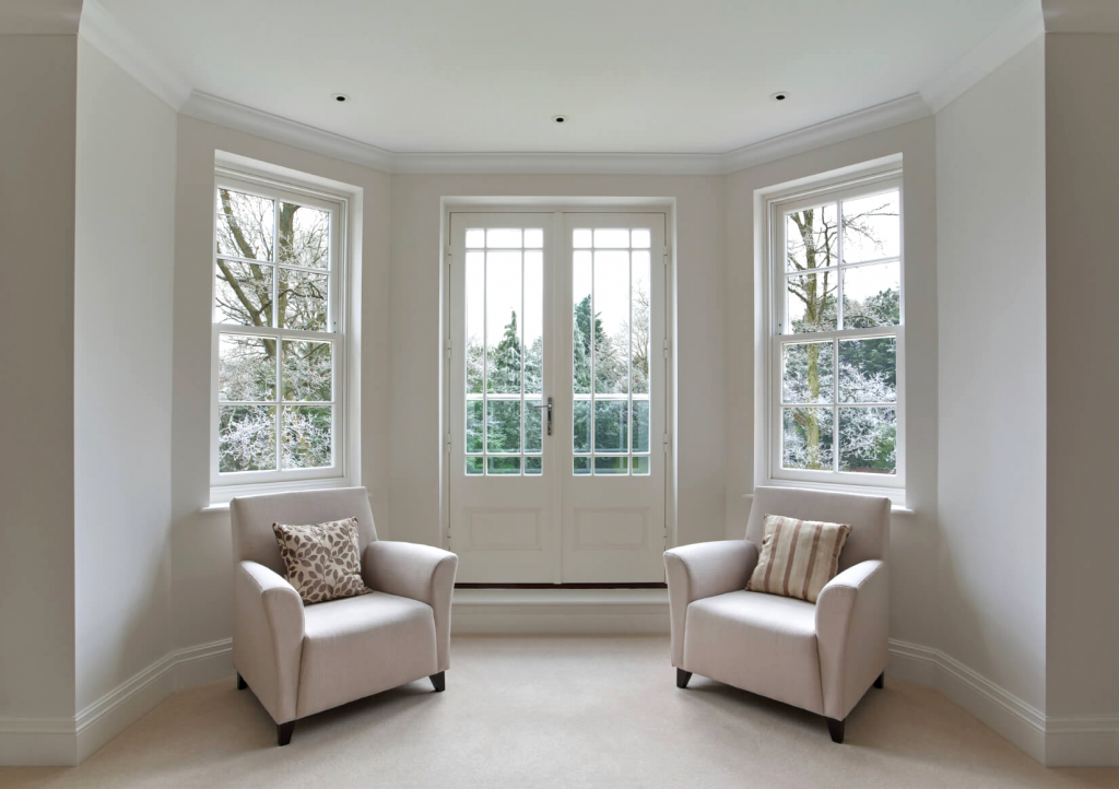 inside view of sash windows with 2 chairs on display