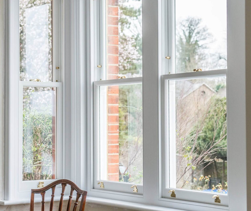 Sash windows looking out onto a tree and garden